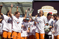 Sky Blue FC's Christie Rampone, left and Natasha Kai, right hold up the WPS Trophy after winning the WPS Championship match 1-0 over LA Sol at the Home Depot Center, Saturday, August 22, 2009.