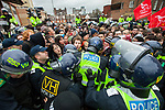 © Joel Goodman - 07973 332324 - all rights reserved . 05/02/2011 . Luton , UK . Police hold back anti-fascist counter protesters . The English Defence League ( EDL ) hold a march and demonstration against Islamic fundamentalism in Luton . Photo credit : Joel Goodman