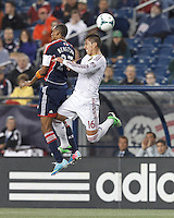 New England Revolution forward Jerry Bengtson (27) and Real Salt Lake defender Carlos Salcedo (16) battle for head ball.  In a Major League Soccer (MLS) match, Real Salt Lake (white)defeated the New England Revolution (blue), 2-1, at Gillette Stadium on May 8, 2013.