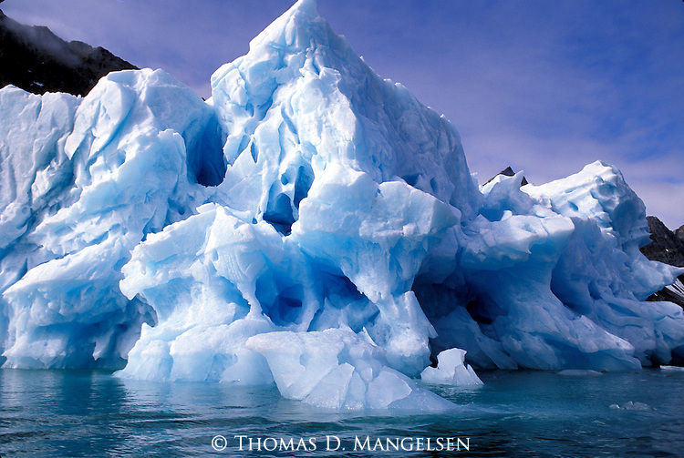 Iceberg floating off the coast of Svalbard, Norway.