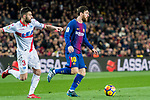 Lionel Andres Messi (R) of FC Barcelona is followed by Ruben Duarte of Deportivo Alaves during the La Liga 2017-18 match between FC Barcelona and Deportivo Alaves at Camp Nou on 28 January 2018 in Barcelona, Spain. Photo by Vicens Gimenez / Power Sport Images