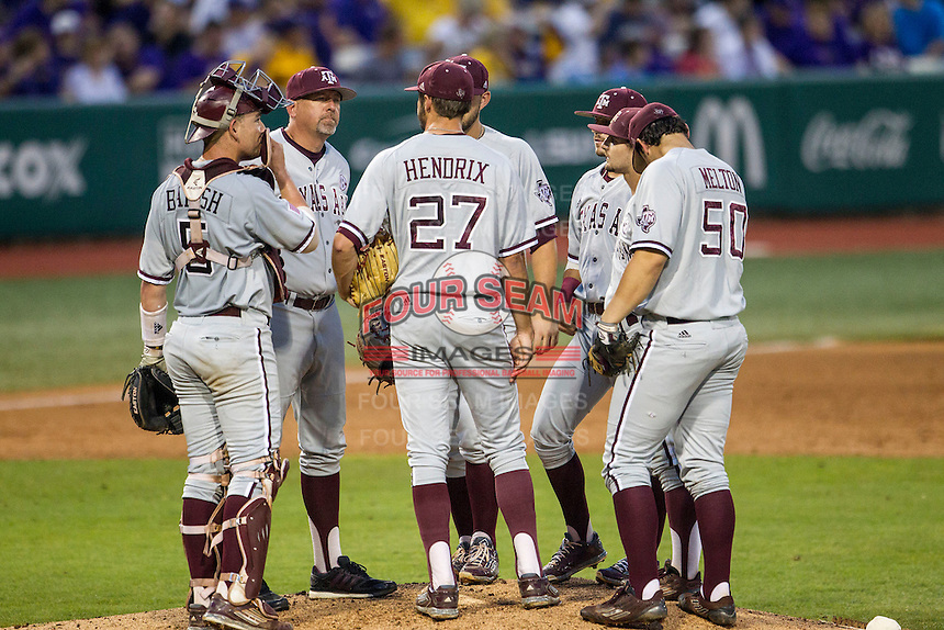 Texas A&M Aggies Head Coach Rob Childress meets with his team on the mound during a Southeastern Conference baseball game against the LSU Tigers on April 24, 2015 at Alex Box Stadium in Baton Rouge, Louisiana. LSU defeated Texas A&M 9-6. (Andrew Woolley/Four Seam Images)