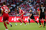 Bayern Munich Forward Thomas Muller (L) plays against AC Milan Midfielder Hakan Calhanoglu (R) during the 2017 International Champions Cup China  match between FC Bayern and AC Milan at Universiade Sports Centre Stadium on July 22, 2017 in Shenzhen, China. Photo by Marcio Rodrigo Machado / Power Sport Images