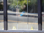 Officials investigate a shooting at an IHOP restaurant in Carson City, Nev., on Tuesday, Sept. 6, 2011, where a gunman killed three people and injured six with an AK-47 before shooting himself. (AP Photo/Cathleen Allison)