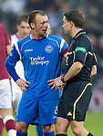 Hearts v St Johnstone...29.01.11  .Jody Morris exchanges words with ref Crawford Allan.Picture by Graeme Hart..Copyright Perthshire Picture Agency.Tel: 01738 623350  Mobile: 07990 594431