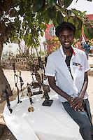 Khadim Diop, Artist Displaying Lost Wax Bronzes, Biiannual Arts Festival, Goree Island, Senegal.