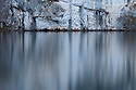 Refelections of limestone cliffs in a mountain lake, Plitvice Lakes National Park, Croatia. January.