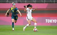 KASHIMA, JAPAN - JULY 27: Christen Press #11 of the United States moves with the ball before a game between Australia and USWNT at Ibaraki Kashima Stadium on July 27, 2021 in Kashima, Japan.