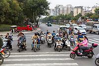 Guilin, China.  Urban Steet Traffic at an Intersection.