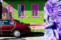 "Irvin Scott, ""Second Chief"", and the rest of the Golden Comanches Mardi Gras Indians parade uptown in New Orleans on February 28, 2006."
