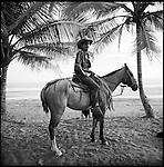 Playa Delfin in Costa Rica is a locals spot with Caballeros on Horse back, water falls and a cafe that serves freshly caught fish