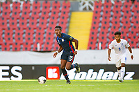 GUADALAJARA, MEXICO - MARCH 28: Andres Perea #15 of the United States looking for an open teammate during a game between Honduras and USMNT U-23 at Estadio Jalisco on March 28, 2021 in Guadalajara, Mexico.