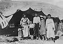 Iran 1947.In summer , the Ghassemlou family in the mountains around Kani Devali, above Bar Baran. In the middle, Ali Ghassemlou, brother of Abdul Rahman Ghassemlou, next to him, left, Hassan Shatavi and the first wife of Ibrahim Ghassemlou.Iran 1947.Pendant l'ete, transhumance a Kani Devali, au-dessus de Bar Baran, des membres de la famille Ghassemlou dont au milieu Ali ghassemlou, frere de Abdul Rahman Ghassemlou, a cote de lui, a gauche, Hassan Shatavi et a cote de Hassan,la premiere femme de Ibrahim Ghassemlou.