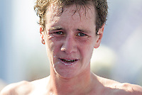16 SEP 2012 - NICE, FRA - Alistair Brownlee of EC Sartrouville recovers after finishing the final stage of the French Grand Prix triathlon series held during the Triathlon de Nice Côte d'Azur .(PHOTO (C) 2012 NIGEL FARROW)