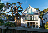 BNPS.co.uk (01202 558833)Pic:  RogerArbon/BNPS<br /> <br /> The rear of the Sandbanks property, showing the two damaged trees.<br /> <br /> A millionaire who butchered protected trees that blocked out the sunlight to his two balconies and patio has been ordered to pay almost £60,000.<br /> <br /> Trevor Beale breached a Tree Preservation Order (TPO) by destroying the canopies of the 60ft tall Scots Pines at the back of his luxury home in Sandbanks, Poole, Dorset.<br /> <br /> In doing so he improved the natural light on his property's rear patio and two balconies as well as increased the value of his £1.2m property by 3.5 per cent.<br /> <br /> Beale, 58, should have sought permission from the local authority before carrying out work on the mature trees, one of which was in a neighbouring garden.<br /> <br /> He pleaded guilty to two charges of contravening tree preservation regulations at a previous hearing.