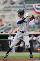 Right fielder Brandon Thomas (32) of the Charleston RiverDogs bats in a game against the Kannapolis Intimidators on Saturday, June 28, 2014, at CMC-Northeast Stadium in Kannapolis, North Carolina. Kannapolis won, 4-3. (Tom Priddy/Four Seam Images)
