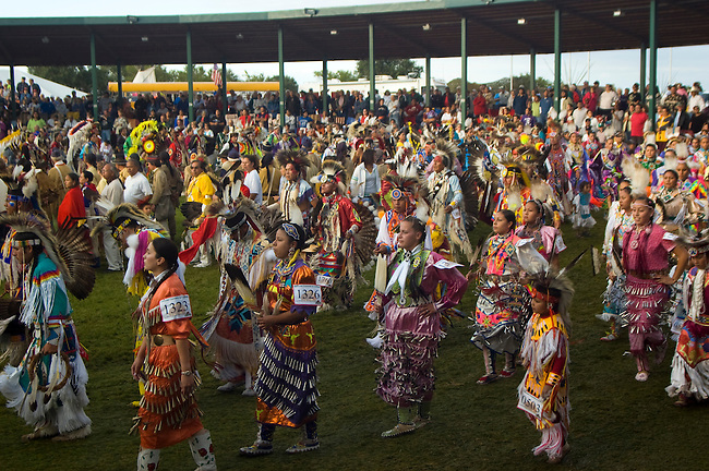 Colorful pow wow dancers and participants during Grand Entry in the dance arena on the Fort Berthold Indian Reservation, North Dakota