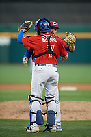 Buffalo Bisons relief pitcher Justin Shafer (33) and catcher Reese McGuire (7) hug after closing out an International League game against the Norfolk Tides on June 22, 2019 at Sahlen Field in Buffalo, New York.  Buffalo defeated Norfolk 3-0.  (Mike Janes/Four Seam Images)