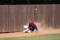 Shippensburg Raiders left fielder Grant Hoover (18) sides into the wall while chasing after the baseball during the game against the Belmont Abbey Crusaders at Abbey Yard on February 8, 2015 in Belmont, North Carolina.  The Raiders defeated the Crusaders 14-0.  (Brian Westerholt/Four Seam Images)