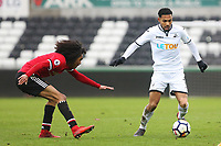 Sunday 18 March 2018<br /> Pictured:  Tahith Chong of Manchester United marks Kenji Gorre of Swansea City<br /> Re: Swansea City v Manchester United U23s in the Premier League 2 at The Liberty Stadium on March 18, 2018 in Swansea, Wales.