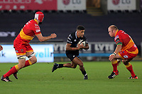 Keelan Giles of the Ospreys (C) against Joseph Davies (L) and Brok Harris of the Dragons (R) during the Guinness PRO14 match between Ospreys and Dragons at The Liberty Stadium, Swansea, Wales, UK. Friday 27 October 2017