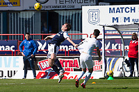 24th April 2021; Dens Park, Dundee, Scotland; Scottish Championship Football, Dundee FC versus Raith Rovers; Paul McGowan of Dundee challenges for the ball with Reghan Tumilty of Raith Rovers