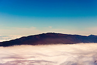 Haleakala or the East Maui Volcano, elevation of 10,023 ft (3,055 m), standing above massive clouds, Maui, Hawaii, USA