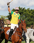 WELLINGTON, FL - NOVEMBER 25:  Team Brazil, Caio Mello waves to the crowd as he passes by the stands, at the USPA International Cup at the Grand Champions Polo Club, on November 25, 2017 in Wellington, Florida. (Photo by Liz Lamont/Eclipse Sportswire/Getty Images)