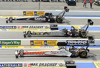 Apr. 15, 2012; Concord, NC, USA: NHRA top fuel dragster driver Steve Torrence (top) Bob Vandergriff Jr (middle) and Clay Millican during eliminations for the Four Wide Nationals at zMax Dragway. Mandatory Credit: Mark J. Rebilas-