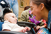 Amy Orr at the Share and Care Network's annual retreat held at the Doubletree Guest Suites Hotel in Boston on May 20, 2006. <br /> <br /> The Share and Care Network was created in 1981 by Pat Cahill when her son Scott was diagnosed with Cockayne Syndrome.  A rare form of dwarfism, Cockayne Syndrome is a genetically determined condition whose symptoms include microcephaly, mental retardation, progressive blindness, progressive hearing loss, premature aging, and a shortened lifespan averaging 18 years.  Those afflicted have distinctive facial features, including sunken eyes, pinched faces, and protruding jaws as well as distinctive gregarious, affectionate personalities.<br /> <br /> Because of the rarity of the condition (1/1,000 live births) and its late onset (characteristics usually begin to appear only after one year), many families and physicians are often baffled by children whose health begins to deteriorate after normal development.  It was partly with this in mind that the Share and Care Network was formed, to promote awareness of this disease as well as to provide a support network for those families affected.  In 1998 it began organizing an annual retreat, which has grown from three families in its inaugural year to more than 30 today.  Although the retreat takes place in the United States, families from as far as Japan arrive for this one weekend out of the year to share information and to support one another.