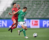 18th May 2020, WESERSTADION, Bremen, Germany; Bundesliga football, Werder Bremen versus Bayer Leverkusen; Maximilian Eggestein (Bremen) holds off the challenge from Charles Aranguiz (Leverkusen)