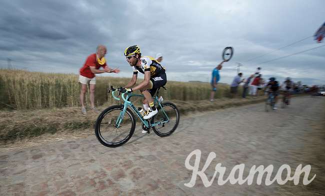 having dislocated his shoulder the day before, it's all gonna hurt extra on the cobbled sector of Artres (1200m) for Laurens ten Dam (NLD/LottoNL-Jumbo)<br /> <br /> stage 4: Seraing (BEL) - Cambrai (FR) <br /> 2015 Tour de France