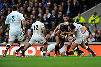 Julian Savea of New Zealand is tackled by Brad Barritt of England during the QBE International match between England and New Zealand at Twickenham Stadium on Saturday 8th November 2014 (Photo by Rob Munro)
