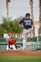 GCL Orioles Jordan Cannon (35) leads off first base as pitcher Miguel Jerez (33) delivers a pitch during a Gulf Coast League game against the GCL Braves on August 5, 2019 at Ed Smith Stadium in Sarasota, Florida.  GCL Orioles defeated the GCL Braves 4-3 in the first game of a doubleheader.  (Mike Janes/Four Seam Images)
