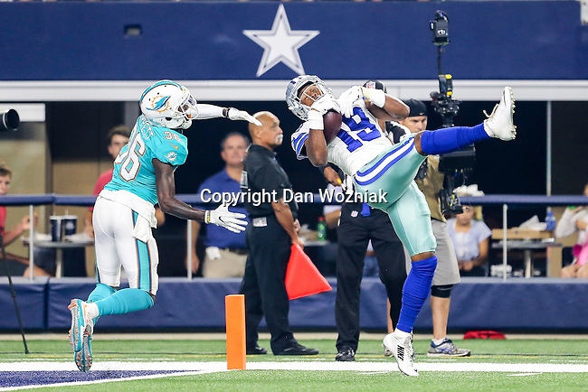 Dallas Cowboys wide receiver Brice Butler (19) and Miami Dolphins defensive back Tony Lippett (36) in action during the pre-season game between the Miami Dolphins and the Dallas Cowboys at the AT & T stadium in Arlington, Texas.