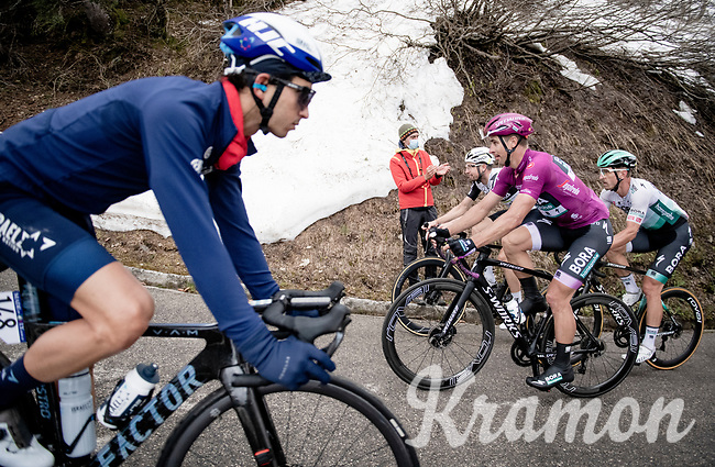 grupetto, including Peter Sagan (SVK/BORA - hansgrohe), up the final part of the Monte Zoncolan while already finished riders are coming back down towards the team buses<br /> <br /> 104th Giro d'Italia 2021 (2.UWT)<br /> Stage 14 from Cittadella›Monte Zoncolan (205km)<br /> <br /> ©kramon