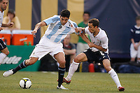 Argentina forward Julio Cruz (9) and United States defender Steve Cherundolo (6). The men's national teams of the United States and Argentina played to a 0-0 tie during an international friendly at Giants Stadium in East Rutherford, NJ, on June 8, 2008.