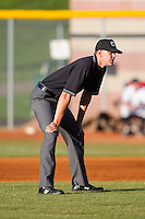 Umpire Travis Eggert handles the calls on the bases during an Appalachian League game between the Greeneville Astros and the Bristol White Sox at Boyce Cox Field July 1, 2010, in Bristol, Tennessee.  Photo by Brian Westerholt / Four Seam Images
