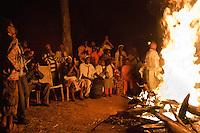 Dorze people dance at bonfire in Ethiopia