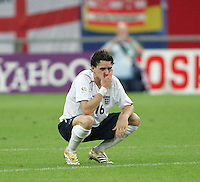 English midfielder (16) Owen Hargreaves sits on the field after penalty kicks have been taken.  Portugal defeated England on penalty kicks after playing to a 0-0 tie in regulation in their FIFA World Cup quarterfinal match at FIFA World Cup Stadium in Gelsenkirchen, Germany, July 1, 2006.