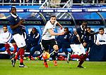 Frankrijk, Parijs, 13 november 2015<br /> Oefenwedstrijd<br /> Frankrijk-Duitsland (2-0)<br /> V.l.n.r.: Paul Pogba van Frankrijk, Jonas Hector van Duitsland en Bacary Sagna van Frankrijk strijden om de bal