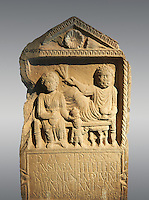 Second century Roman Christian funerary stele for 3 dead people from Africa Proconsularis. The stele depicts the deceased:  Fausata who died age 75, a man who died age 70 and a child who died age 2 years 6 months. From the first half of the second century AD from the region of Bou Arada in present day Tunisia. The Bardo National Museum, Tunis, Tunisia.   Against a grey background.