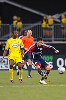 25 OCTOBER 2009:  Guillermo Barros Schelotto of the Columbus  (7)Crew and Jay Heaps of the New England Revolution (6) during the New England Revolution at Columbus Crew MLS game in Columbus, Ohio on October 25, 2009.