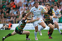 Luke Arscott of Exeter Chiefs hands off Ryan Lamb of Northampton Saints as Dom Waldouck of Northampton Saints (right) looks on during the Aviva Premiership match between Northampton Saints and Exeter Chiefs at Franklin's Gardens on Sunday 9th September 2012 (Photo by Rob Munro)