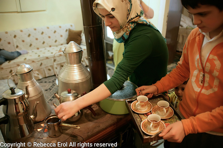 Making Turkish coffee on a traditional soba (stove) in Istanbul, Turkey