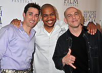 """PAUL J. ALESSI, producer/actor & OMAR GOODING & STEVEN GASWIRTH.""""Knuckle Draggers"""" Premiere at the 2009 Newport Beach Film Festival held at Edwards Cinemas, Newport Beach, CA, USA..April 27th, 2009.half length red dress white shirt purple black hands .CAP/ADM/BP.©Byron Purvis/AdMedia/Capital Pictures."""
