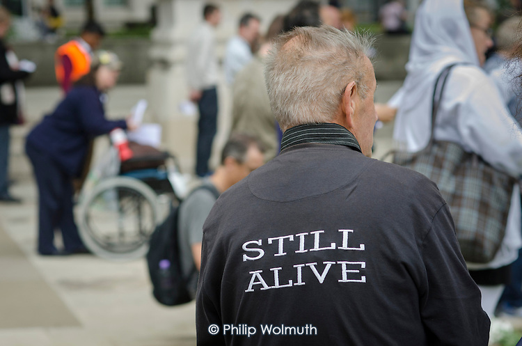 10,000 Cuts and Counting memorial service in Parliament Square, London, to commemorate those who have died shortly after undergoing a Work Capability Assessment by government contractor Atos.