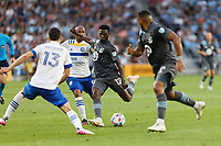 SAINT PAUL, MN - JULY 3: Bakaye Dibassy #12 of Minnesota United FC with the ball during a game between San Jose Earthquakes and Minnesota United FC at Allianz Field on July 3, 2021 in Saint Paul, Minnesota.