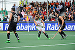 The Hague, Netherlands, June 03: (R-L) Kane Russell #21 of New Zealand and Jonathan Robinson #1 of South Africa watch the ball during the field hockey group match (Men - Group B) between South Africa and the Black Sticks of New Zealand on June 3, 2014 during the World Cup 2014 at GreenFields Stadium in The Hague, Netherlands. Final score 0:5 (0:3) (Photo by Dirk Markgraf / www.265-images.com) *** Local caption ***