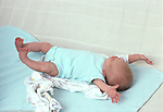 newborn baby girl, 3 weeks old, on back, full length,<br />
